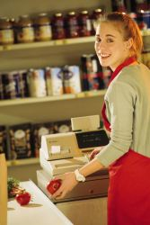 Teen girl work as a cashier at a grocery store